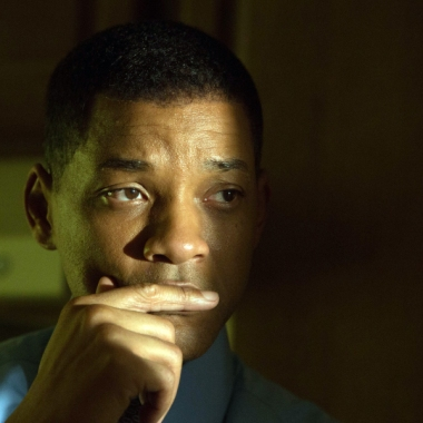 """This image provided by Columbia Pictures shows, Will Smith as Dr. Bennet Omalu, in a scene from Columbia Pictures' """"Concussion."""" The movie releases in U.S. theaters on Dec. 25, 2015. (Melinda Sue Gordon/Columbia Pictures via AP) ORG XMIT: CAET551"""