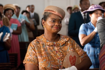 """THE HELP"" TH-285 Minny Jackson (Octavia Spencer) looks on as her friend Aibileen is applauded for her courage by their fellow churchgoers, in DreamWorks PicturesÕ inspiring drama, ÒThe Help,Ó based on the New York Times best-selling novel by Kathryn Stockett. ÒThe HelpÓ is written for the screen and directed by Tate Taylor, with Brunson Green, Chris Columbus and Michael Barnathan producing. Ph: Dale Robinette ©DreamWorks II Distribution Co., LLC. ÊAll Rights Reserved."