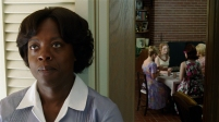 """""""THE HELP"""" FF-001 Aibileen Clark (Viola Davis) overhears the exchange between Skeeter Phelan (Emma Stone, center) and her friends in DreamWorks Pictures' drama, """"The Help"""", based on the New York Times best-selling novel by Kathryn Stockett. ©DreamWorks II Distribution Co., LLC. ÊAll Rights Reserved."""