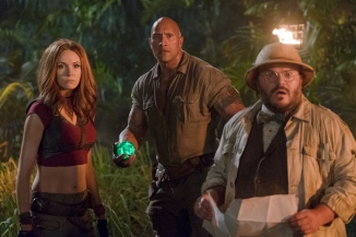 Karen Gillan, Dwayne Johnson and Jack Black star in JUMANJI: WELCOME TO THE JUNGLE.